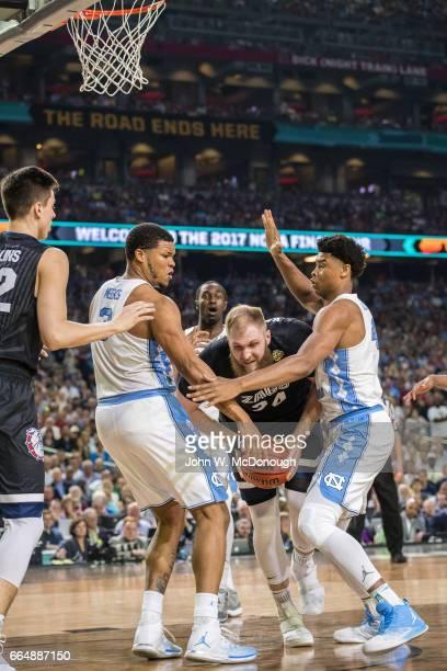 NCAA Finals Gonzaga Przemek Karnowski in action vs North Carolina Kennedy Meeks and Isaiah Hicks at University of Phoenix Stadium Glendale AZ CREDIT...