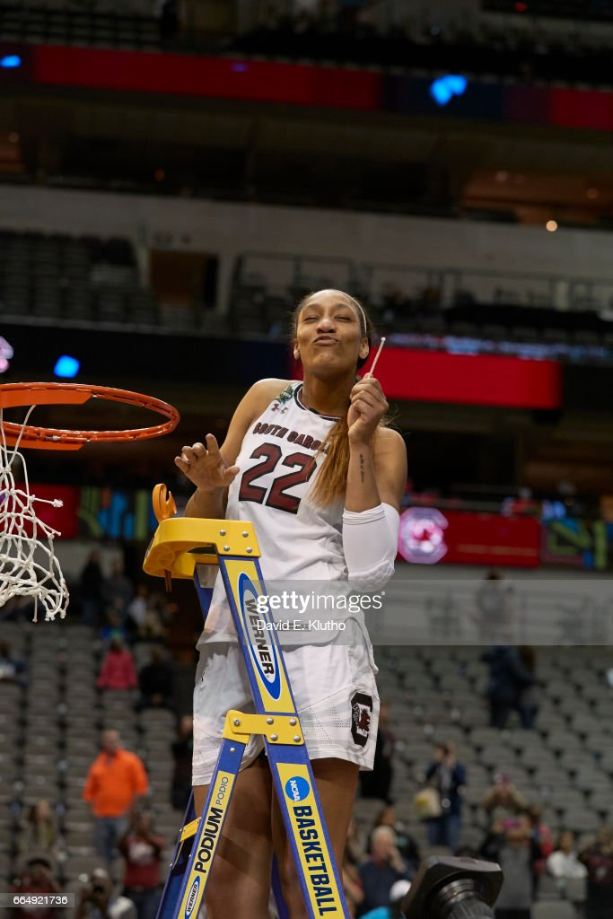 South Carolina A'ja Wilson (22) victorious on ladder after cutting net after winning game vs Mississippi State at American Airlines Center. David E. Klutho SI798 TK1 )