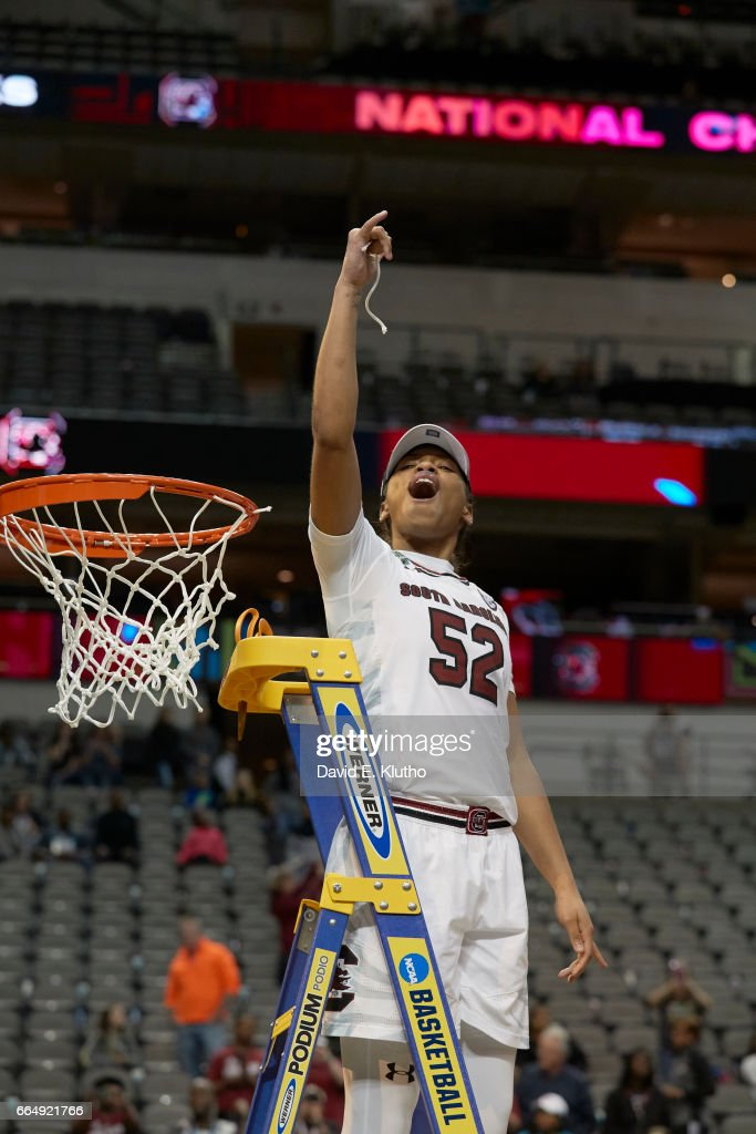South Carolina Tyasha Harris (52) victorious on ladder after cutting net after winning game vs Mississippi State at American Airlines Center. David E. Klutho SI798 TK1 )