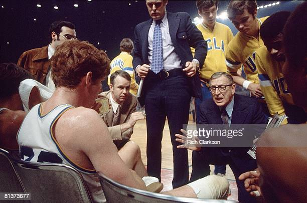 College Basketball NCAA finals UCLA coach John Wooden talks to Bill Walton during game vs Florida State Los Angeles CA 3/25/1972