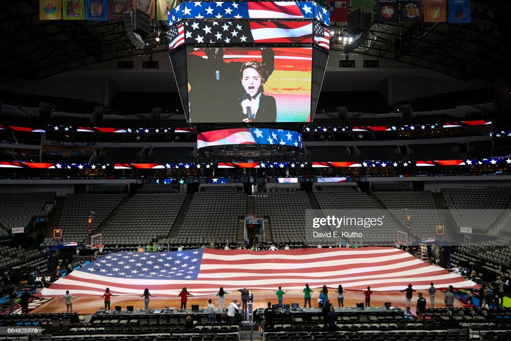 View of USA flag unfurled on court during rehearsal for anthem before South Carolina vs Mississippi State game at American Airlines Center. David E. Klutho SI798 TK1 )