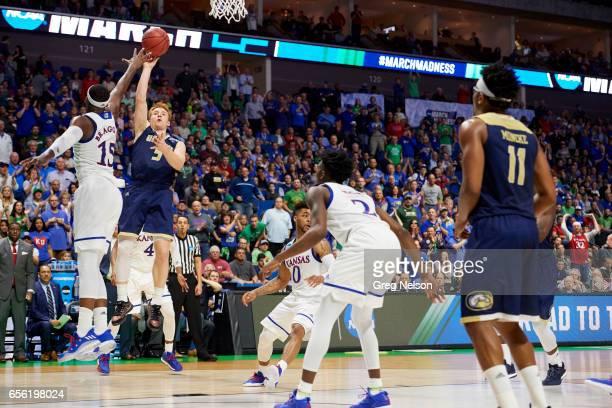 NCAA Playoffs California Davis Siler Schneider in action vs Kansas Carlton Bragg Jr at BOK Center Tulsa OK CREDIT Greg Nelson