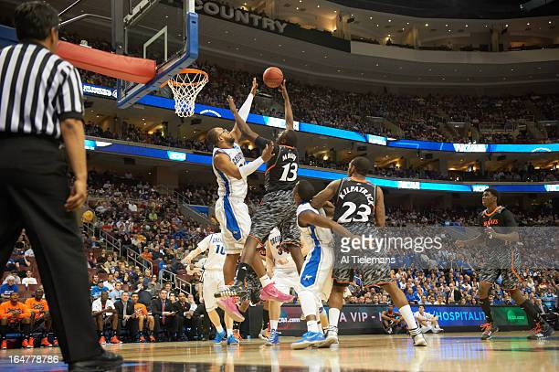 NCAA Playoffs Creighton Gregory Echenique in action vs Cincinnati Cheikh Mbodj at Wells Fargo Center Philadelphia PA CREDIT Al Tielemans