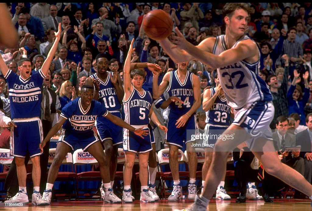 Duke Christian Laettner (32) in action in front of Kentucky bench during game at The Spectrum. John Biever X42666 )
