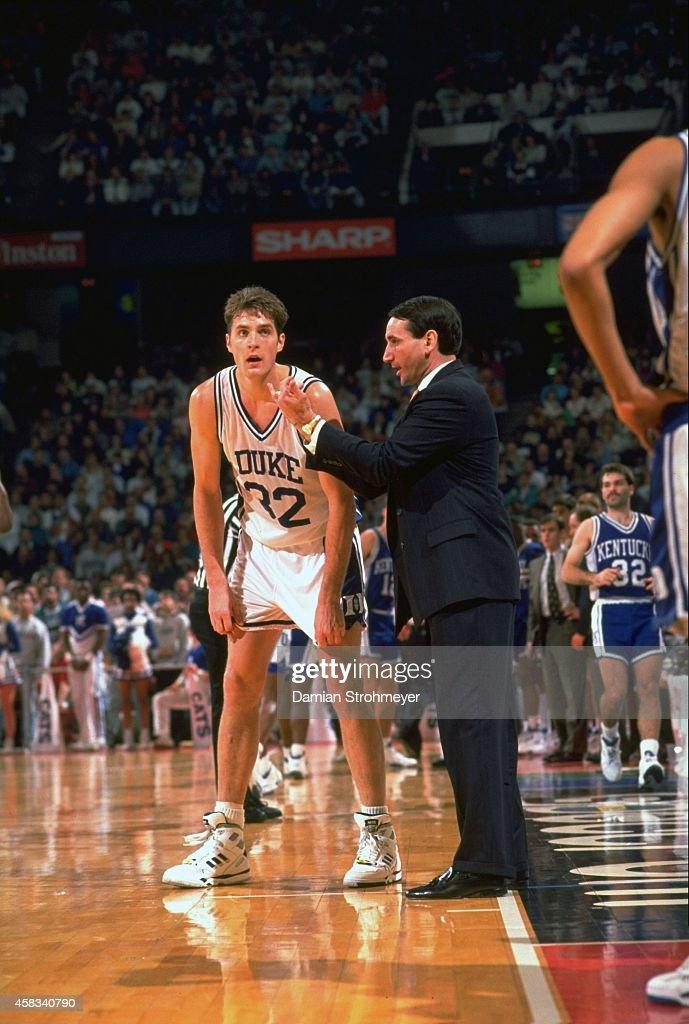 Duke head coach Mike Krzyzewski talking to Christian Laettner (32) during game vs Kentucky at The Spectrum. Damian Strohmeyer X42667 )