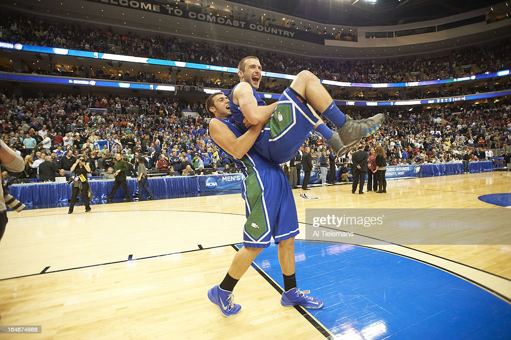 Florida Gulf Coast Chase Fieler (20), victorious, carrying Brett Comer (0) on court after winning game vs Georgetown at Wells Fargo Center. Al Tielemans F120 )