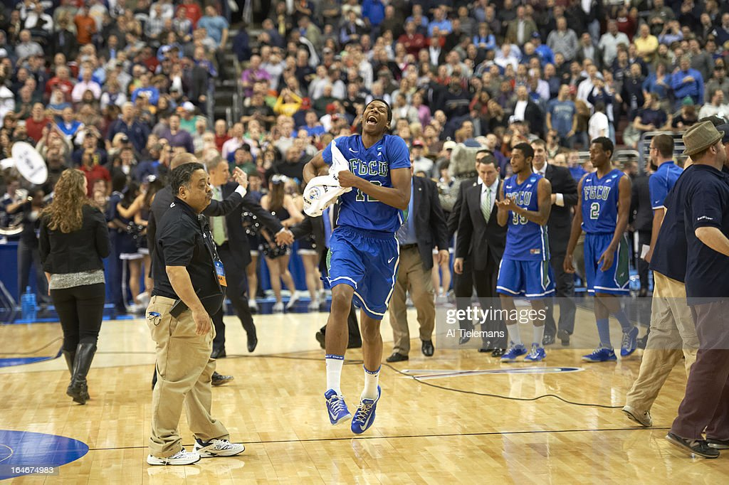 Florida Gulf Coast Eric McKnight (12) victorious on court after winning game vs Georgetown at Wells Fargo Center. Al Tielemans X156289 TK3 R2 F328 )