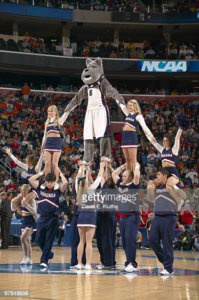 NCAA Playoffs Gonzaga Bulldogs mascot Spike the Bulldog performing pyramid with cheerleaders on court during game vs Florida State Buffalo NY...