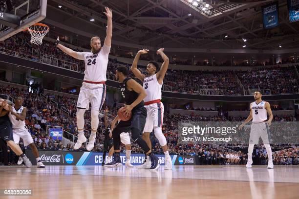 NCAA Playoffs Gonzaga Przemek Karnowski and Johnathan Williams in action defense vs Xavier Trevon Bluiett at SAP Center San Jose CA CREDIT John W...