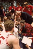 College Basketball NCAA Playoffs Indiana coach Bobby Knight in huddle with team during game vs Marquette Baton Rouge LA 3/21/1976