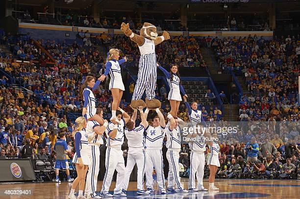 NCAA Playoffs Kentucky Wildcats mascot The Wildcat forming pyramid with cheerleaders on court during game vs Wichita State at Scottrade Center St...
