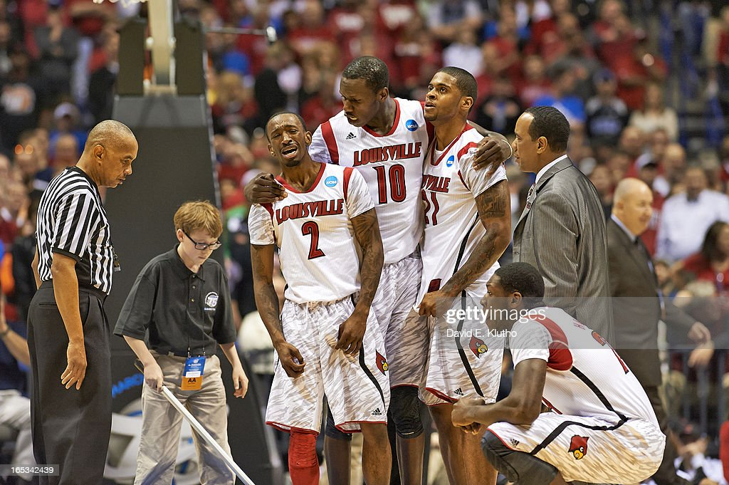Louisville Russ Smith (2), Gorgui Dieng (10), and Chane Behanan (21) upset after compound fracture leg injury to Kevin Ware (5) during game vs Duke at Lucas Oil Stadium. David E. Klutho X156331 TK1 R1 F36 )