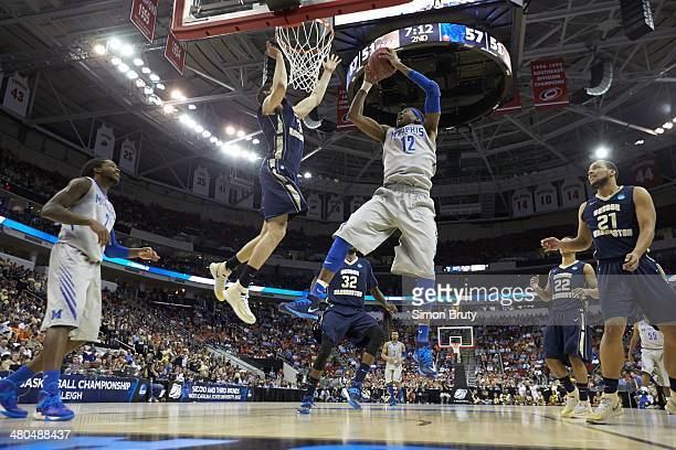 NCAA Playoffs Memphis David Pellom in action layup vs George Washington Miguel Cartagena at PNC Arena Raleigh NC CREDIT Simon Bruty