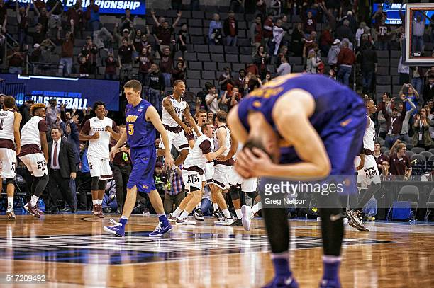 NCAA Playoffs Northern Iowa Matt Bohannon and Klint Carlson upset after losing game as Texas AM players celebrate at Chesapeake Energy Arena Oklahoma...
