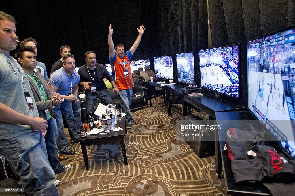 NCAA Playoffs View of sports book patrons betting on March Madness games at Caesars Palace Hotel Casino Las Vegas NV CREDIT Chris Farina