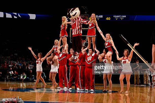 NCAA Playoffs Wisconsin cheerleaders performing pyramid with mascot Bucky Badger on court during game vs Coastal Carolina at CenturyLink Center Omaha...