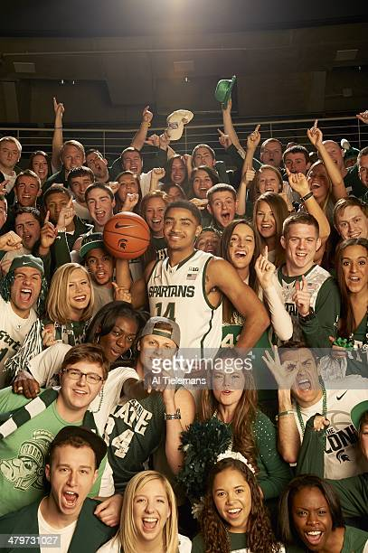NCAA Tournament Preview Portrait of Michigan State guard Gary Harris during photo shoot with student section at Breslin Center East Lansing MI CREDIT...