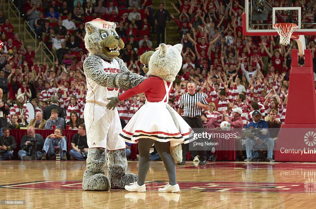 North Carolina State mascot Mr. Wuf and Mrs. Wuf on court during game vs Miami at PNC Arena. Greg Nelson F76 )