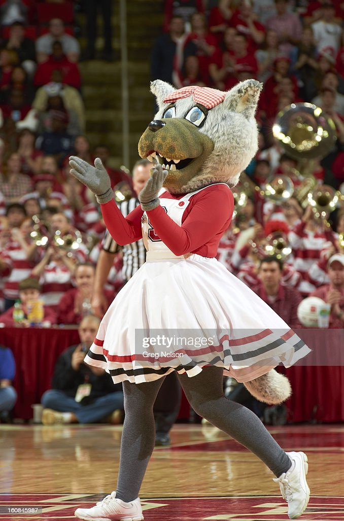 North Carolina State mascot Mrs. Wuf on court during game vs Miami at PNC Arena. Greg Nelson F82 )