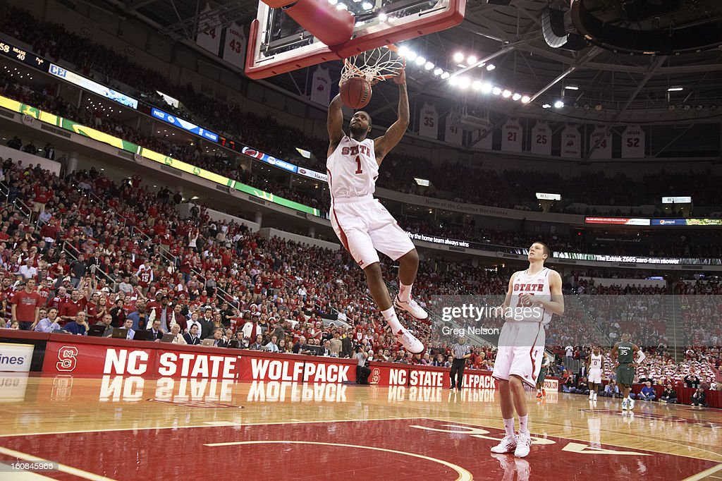 North Carolina State Richard Howell (1) in action, dunking vs Miami at PNC Arena. Greg Nelson F54 )