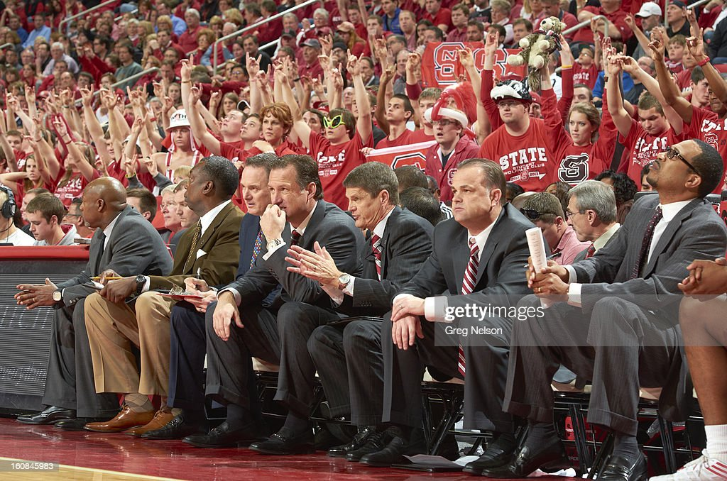 North Carolina State third from (L-R) director of operations Jeff Dunlap, coach Mark Gottfried, associate head coach Bobby Lutz and assistant coach Ron Moxley on bench during game vs Miami at PNC Arena. Greg Nelson F70 )