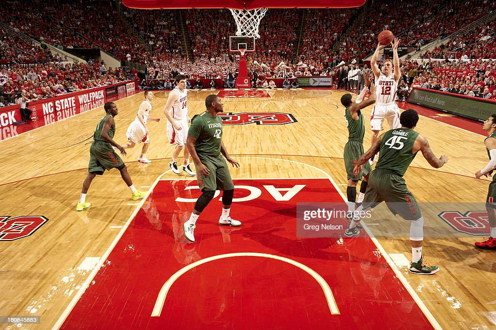 North Carolina State Tyler Lewis (12) in action, shooting vs Miami at PNC Arena. Greg Nelson F64 )