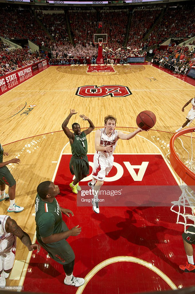 North Carolina State Tyler Lewis (12) in action vs Miami at PNC Arena. Greg Nelson F27 )