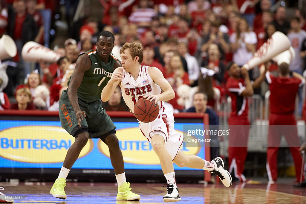 North Carolina State Tyler Lewis (12) in action vs Miami at PNC Arena. Greg Nelson F106 )
