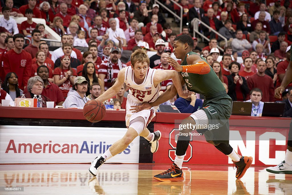 North Carolina State Tyler Lewis (12) in action vs Miami at PNC Arena. Greg Nelson F76 )
