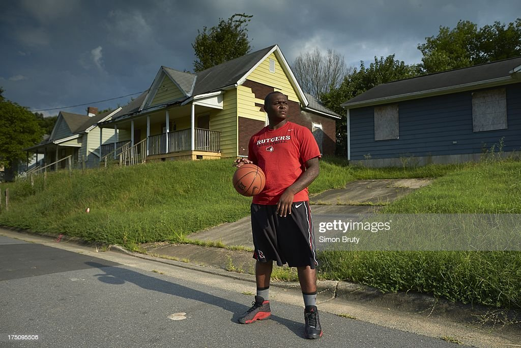 Portrait of former UNC-Wilmington player Tyree Graham in front of his childhood home on Piedmont Avenue. Graham, who has played at multiple colleges and high schools during his career, represents the high frequency of transfers over the last seven seasons. Simon Bruty F351 )