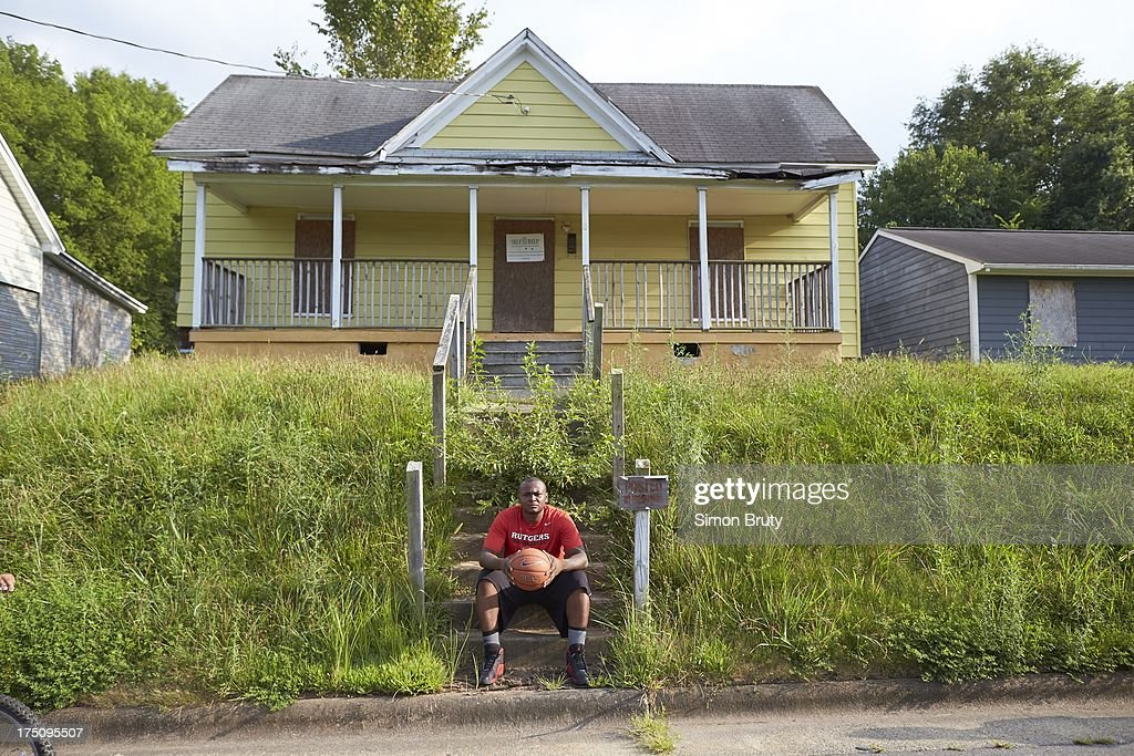 Portrait of former UNC-Wilmington player Tyree Graham in front of his childhood home on Piedmont Avenue. Graham, who has played at multiple colleges and high schools during his career, represents the high frequency of transfers over the last seven seasons. Simon Bruty F358 )