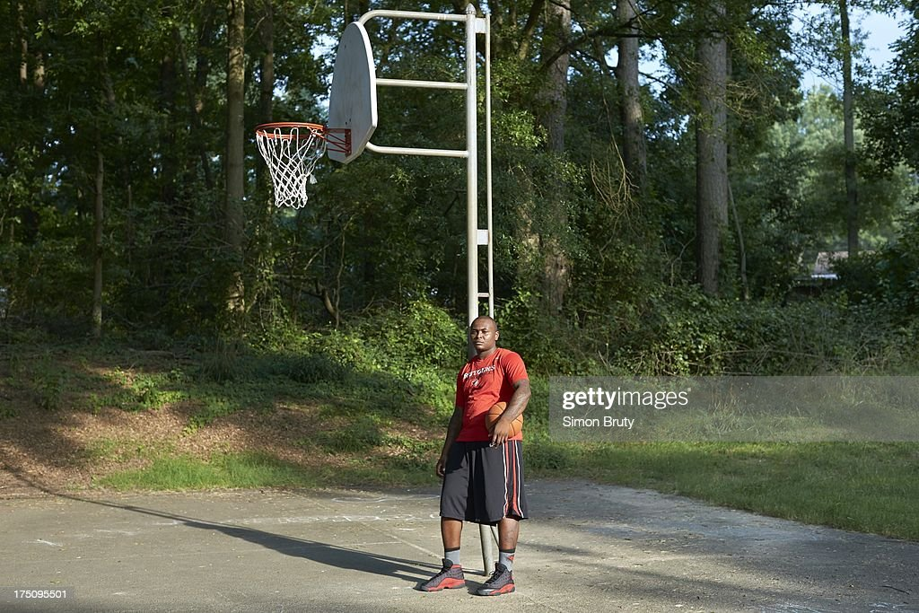 Portrait of former UNC-Wilmington player Tyree Graham on playground court near his childhood home. Graham, who has played at multiple colleges and high schools during his career, represents the high frequency of transfers over the last seven seasons. Simon Bruty F180 )