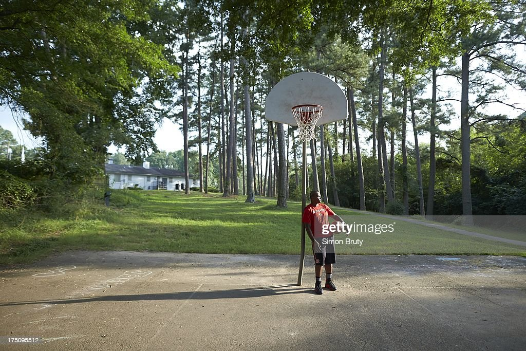 Portrait of former UNC-Wilmington player Tyree Graham on playground court near his childhood home. Graham, who has played at multiple colleges and high schools during his career, represents the high frequency of transfers over the last seven seasons. Simon Bruty F518 )