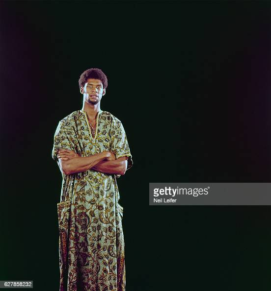 Portrait of Milwaukee Bucks Lew Alcindor wearing African dashiki during photo shoot in studio New York NY CREDIT Neil Leifer