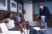 College Basketball Portrait of North Carolina Sam Perkins Michael Jordan and coach Dean Smith in office at University of North Carolina Chapel Hill NC