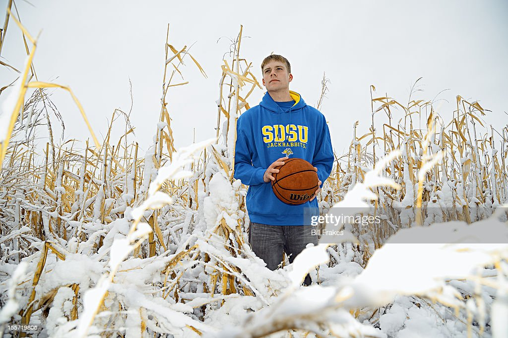 Portrait of South Dakota State point guard Nate Wolters casual during photo shoot in a snowy cornfield. Bill Frakes F48 )