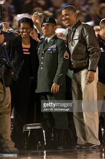 Quicken Loans Carrier Classic United States President Barack Obama and first lady Michelle Obama posing for picture with a soldier before Michigan...