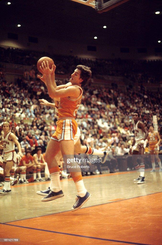 Tennessee Ernie Grunfeld (22) in action, rebounding vs Auburn at Beard-Eaves-Memorial Coliseum. Bruce Roberts F7 )