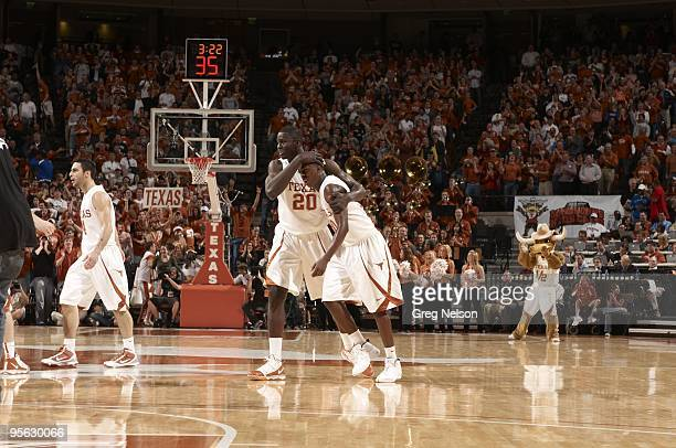 Texas J'Covan Brown and Alexis Wangmere victorious during game vs Michigan State Austin TX CREDIT Greg Nelson