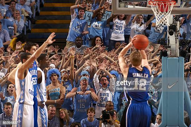 View of North Carolina fans in stands behind basket during free throw attempting to distract Duke player during game Chapel Hill NC 3/8/2009 CREDIT...