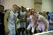 Yale Brandon Sherrod victorious holding Ivy League Men's Basketball Trophy with teammates after winning game vs Columbia at Levien Gymnasium New York...
