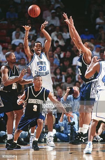 North Carolina Rasheed Wallace in action pass vs Georgetown Allen Iverson Birmingham AL 3/23/1995 CREDIT John Biever