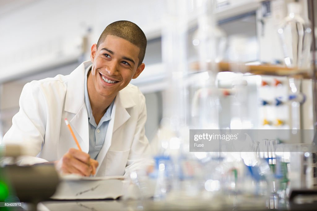 College Chemistry Student Working in Lab
