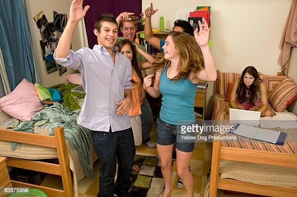 College coeds  dancing in dorm room
