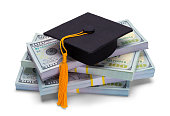 Pile of Money with Graduation Hat Isolated on White Background.