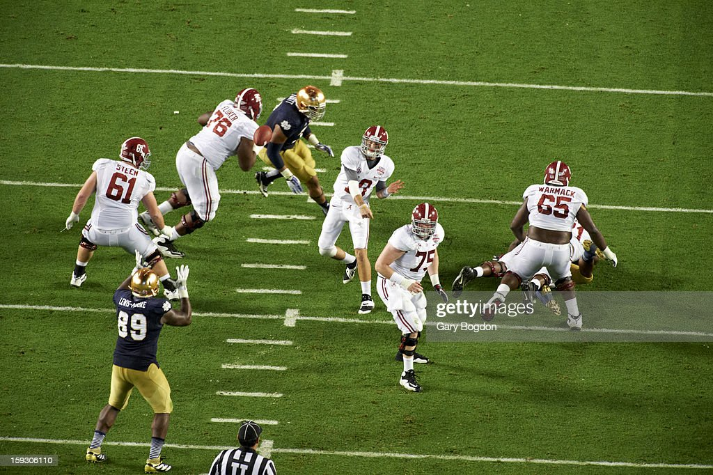 Alabama AJ McCarron (10) in action, passing vs Notre Dame at Sun Life Stadium. Gary Bogdon F37 )