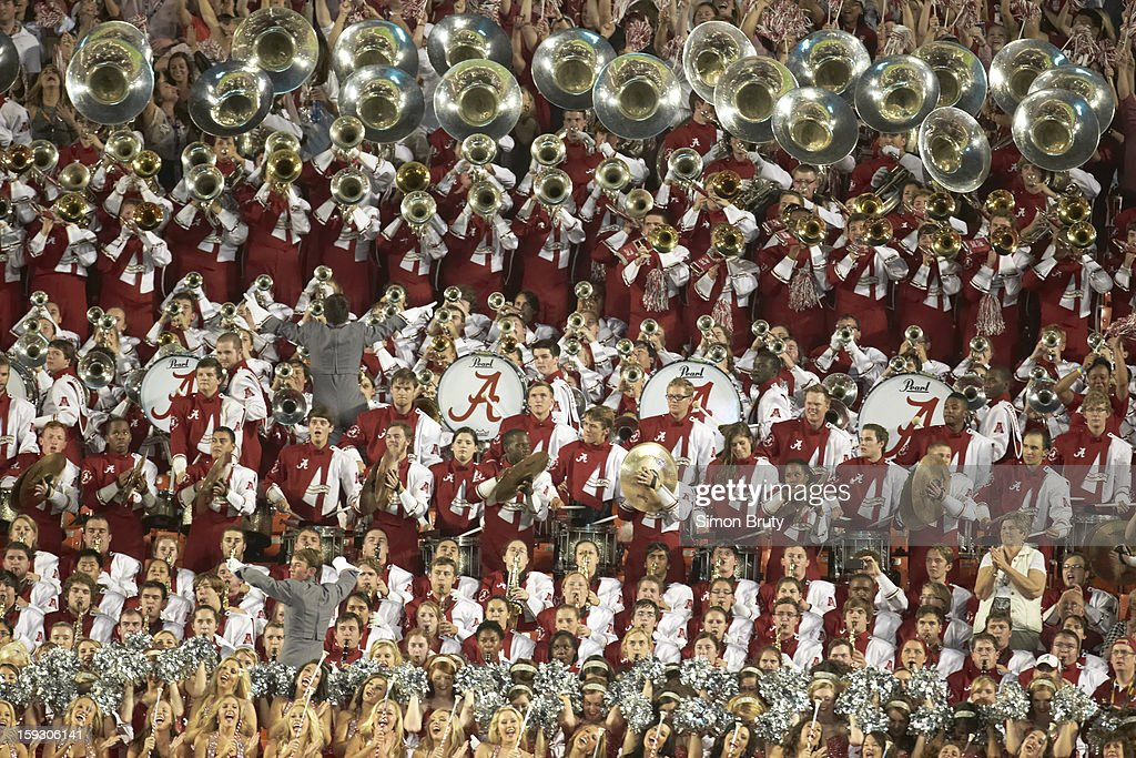 Alabama cheerleaders and band in stands during game vs Notre Dame at Sun Life Stadium. Simon Bruty F106 )