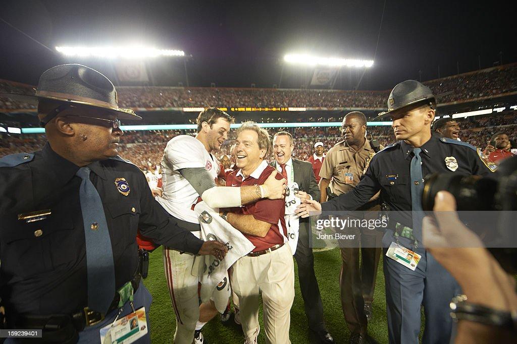 Alabama coach Nick Saban victorious with QB AJ McCarron (10) after winning game vs Notre Dame at Sun Life Stadium. John Biever F8 )