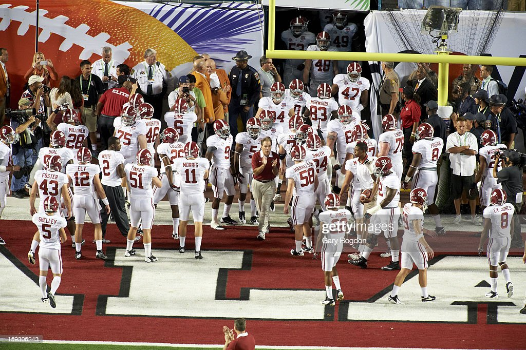 Alabama coach Nick Saban taking field with players before game vs Notre Dame at Sun Life Stadium. Gary Bogdon F33 )