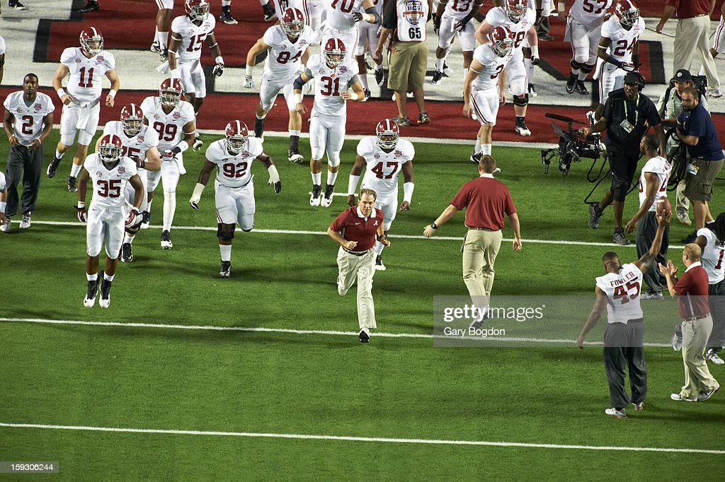 Alabama coach Nick Saban taking field with players before game vs Notre Dame at Sun Life Stadium. Gary Bogdon F42 )